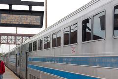 LIRR train arrives in Bay Shore late. Bay Shore N. Y. USA - 29 May 2017: Train arrives late into Bay Shore with the sign showing cancelations and delays because royalty free stock images