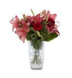 Lis rouges et roses dans un vase en cristal Photo libre de droits