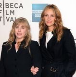 Lisa Roberts Gillan and Julia Roberts. Producer Lisa Roberts Gillan and sister and executive producer Julia Roberts arrive on the red carpet at the 10th Annual Stock Photos