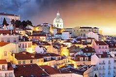 Lisboa at night from miraduro Portas do Sol Stock Images