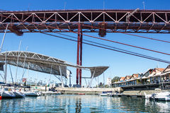 Lisboa, Portugal, Santo Amaro Dock, 25 de Abril Bridge and entertainment area coverage Stock Photography