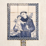 Lisbon – Saint Anthony Tiles. Tile panel with the image Saint Anthony, the patron saint of Lisbon, can be found on the streets of Lisbon, Portugal Royalty Free Stock Photo