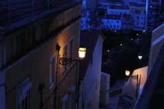 Lisbon alleys in nocturnal cold colors. Narrow alleys Stock Photos