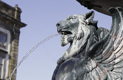 Lisbon ancient source. Detail of a lion spitting water fountain Stock Image