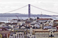 Lisbon bridge and buildings Stock Photography