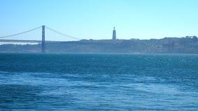 Lisbon bridge and Christ statue Stock Images