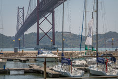 Lisbon Bridge from Marina. 25 Abril Bridge view from the Pier in Santos, Lisbon, Portugal Royalty Free Stock Photography
