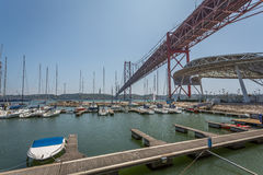 Lisbon Bridge from Marina. 25 Abril Bridge view from the Pier in Santos, Lisbon, Portugal Royalty Free Stock Image