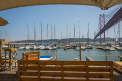 Lisbon Bridge from Marina. 25 Abril Bridge view from the Pier in Santos, Lisbon, Portugal Royalty Free Stock Photos