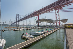 Lisbon Bridge from Marina. 25 Abril Bridge view from the Pier in Santos, Lisbon, Portugal Stock Photo