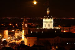 Lisbon cathedral by night. View over Lisbon (Portugal) by night, with the moon over the cathedral Royalty Free Stock Photos