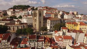 Lisbon Cathedral at sunny day and historical part of Lisbon , Portugal Aerial view stock footage