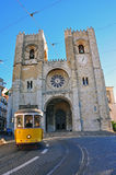 Lisbon cathedral and yellow tram Royalty Free Stock Photos
