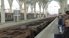 LISBON, circa 2018: Freight train passing through the railway station in Lisbon. Lisbon is continental Europe`s capital. City and the only one along the stock video footage
