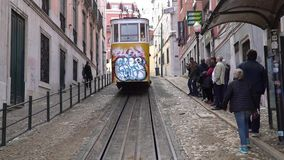 LISBON, circa 2017: Old tram elevator Gloria in the old town of Lisbon Portugal. Lisbon is the capital of Portugal, is. LISBON, circa 2017: Old tram elevator stock video footage