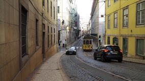 LISBON, circa 2017: Old tram passing by in the old town of Lisbon Portugal. Lisbon is the capital of Portugal. Lisbon is. LISBON, circa 2017: Old tram passing by stock footage