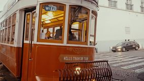 LISBON, circa 2017: Old tram passing by in the old town of Lisbon Portugal. Lisbon is the capital of Portugal. Lisbon is. LISBON, circa 2017: Old tram passing by stock video footage