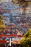 Lisbon city aerial. Red rooftops of Lisbon city view from Sao Jorge castle with cannon in foreground, Portugal royalty free stock image