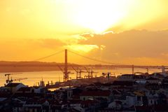 Lisbon city center and 25 de Abril Bridge at sunset. Portugal.  Stock Image