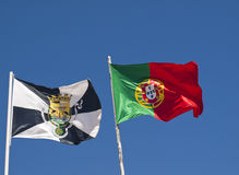 Lisbon city and Portugal flags. Wave in the wind with blue sky royalty free stock photos