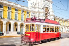 Lisbon city in Portugal. Old tourist tram on the central square with Augusta arch on the background in Lisbon, Portugal Stock Photography
