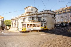 Lisbon city in Portugal. LISBON, PORTUGAL - September 28, 2017: Street view with famous old tourist tram full of people during the sunny day in Lisbon city stock images