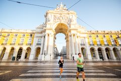 Lisbon city in Portugal. LISBON, PORTUGAL - September 28, 2017: View on the Triumphal arch on the Commerce square during the sunrise in Lisbon city, Portugal royalty free stock photos