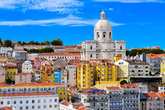Lisbon cityscape. Cityscape of Alfama district in Lisbon, Portugal. National Pantheon Dome with colorful buildings and red rooftops. Beautiful blue sky Stock Image
