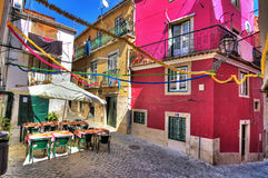 Lisbon colors. Beautiful wide angle image of the tight streets with lots of colors in Lisbon, Portugal Royalty Free Stock Photo
