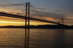 Lisbon. Dawn over the tagus river and tagus bridge, very similar to the golden gate bridge Stock Photos