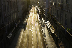Lisbon downtown street. São Paulo street in Lisbon by sunset with electric vehicle rails reflecting the sunlight. Portugal stock photo