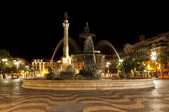 Lisbon, fountain and statue on Rossio square at night Stock Photo