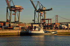 Lisbon harbour, Portugal. Containers and old  ship Stock Photo
