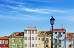 Lisbon Houses. Picturesque Lisbon neighborhood with colorful block of houses under sunny blue sky royalty free stock photo