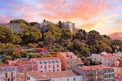 Lisbon houses with the St. Jorge castle in Lisbon Portugal. At sunset Stock Image