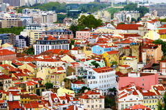 Lisbon houses from the top of an observation tower. The colorful airy city view of Lisbon from the top of a tower elevator Santa Justa lift Stock Images
