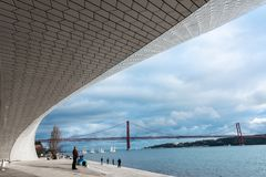 MAAT Museum in Lisbon. LISBON - JANUARY 4, 2018: Incidental people walking along the stairs and main entrance to the Museum of Art, Architecture and Technology stock photography