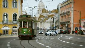 Lisbon, January 2018: an old tram with Santa Claus rides down Lisbon Street near the Jeronimos Monastery. Old tram with Santa Claus rides down Lisbon Street near stock video