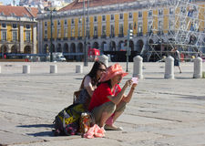 LISBON - JULY 10, 2014: Tourists taking photos on Praca do Comer Stock Images