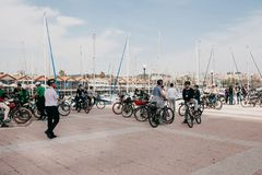 Lisbon, June 18, 2018: A group of tourists on bicycles or athletes admire the beautiful views of the city on the royalty free stock photo