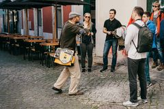 Lisbon, June 18, 2018: A guide from local residents tells tourists on a free tour of the sights of the city. Free tour. From local royalty free stock images