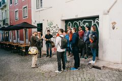 Lisbon, June 18, 2018: A guide from local residents tells tourists on a free tour of the sights of the city. Free tour. From local stock images