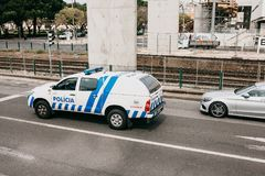 Lisbon, June 18, 2018: A police car is driving down the city street. Protection of public order Stock Image