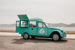 Lisbon, June 18, 2018: Sale of street food or sweets in a vintage or retro car. Street trading or a small business. Lisbon, June 18, 2018: Sale of street food or Royalty Free Stock Photos