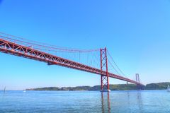 Lisbon, Landmark suspension 25 of April bridge stock photos