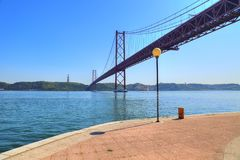 Lisbon, Landmark suspension 25 of April bridge stock photo