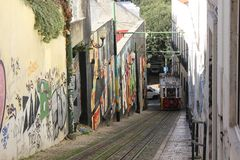 Lisbon Lavra funicolar arriving on the narrow street Stock Photography