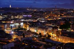 Lisbon night city. Lisbon cityscape in Portugal. Night city view from a miradouro (viewpoint) with Tagus river and 25 de Abril Bridge stock photo