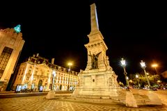 Lisbon by night. A popular Obelisk in Praca dos Restauradores or Restoration Square in honor of Portuguese Independence from Spain in Lisbon downtown, Portugal Royalty Free Stock Image