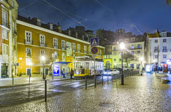Lisbon at night, street, cable car  and old houses of the histor Royalty Free Stock Images